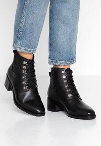 KIOMI - Winter boots - black - 0