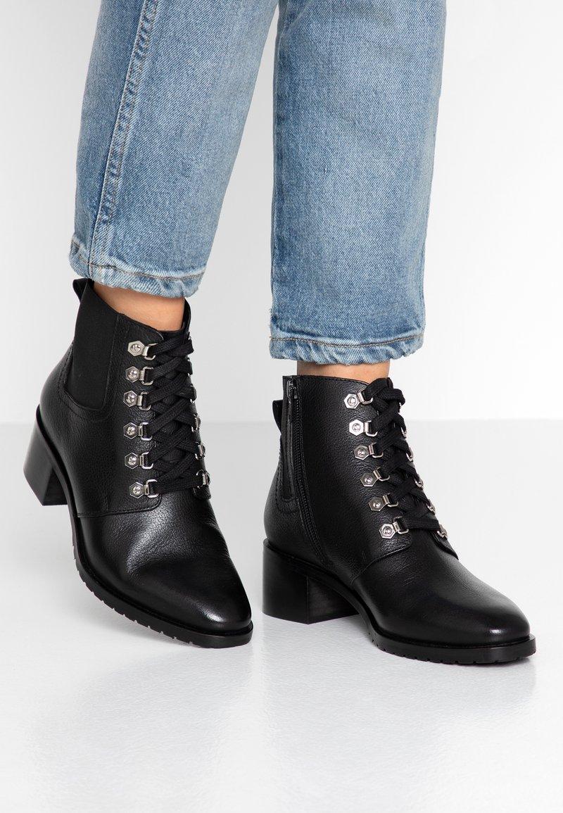 KIOMI - Winter boots - black