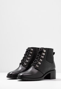 KIOMI - Winter boots - black - 4