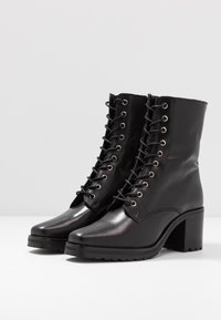 KIOMI - Winter boots - black - 4