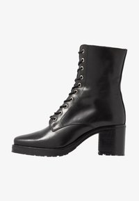 KIOMI - Winter boots - black - 1