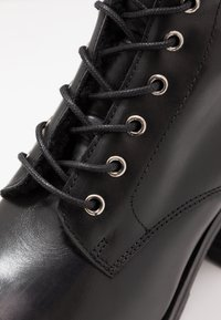 KIOMI - Winter boots - black - 2