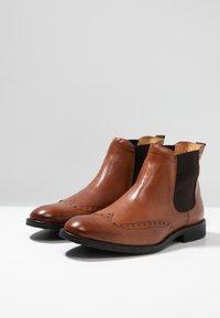 KIOMI - Kotníkové boty - cognac - 2