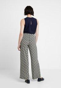 KIOMI - Pantalon classique - off white/black - 2