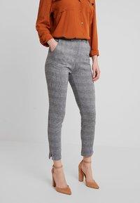 KIOMI - Trousers - black/white - 0
