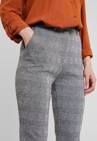 KIOMI - Trousers - black/white - 6