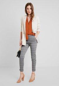 KIOMI - Trousers - black/white - 1