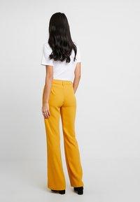 KIOMI - Broek - dark yellow - 2