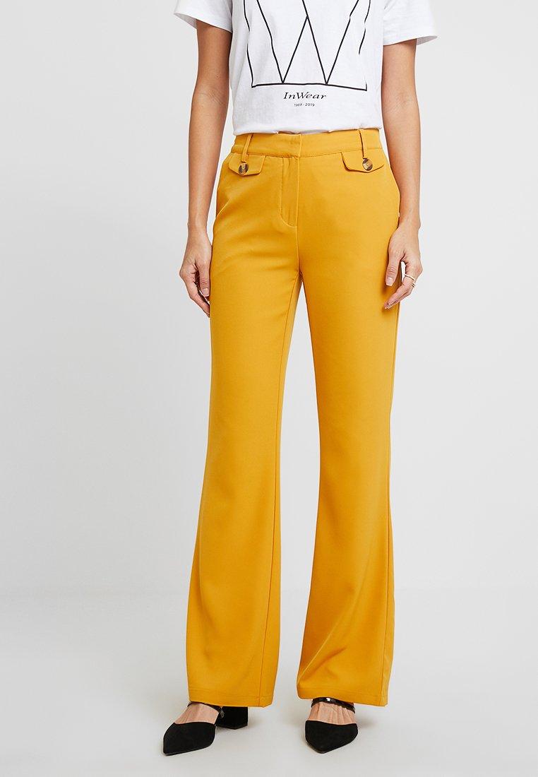 KIOMI - Pantalon classique - dark yellow