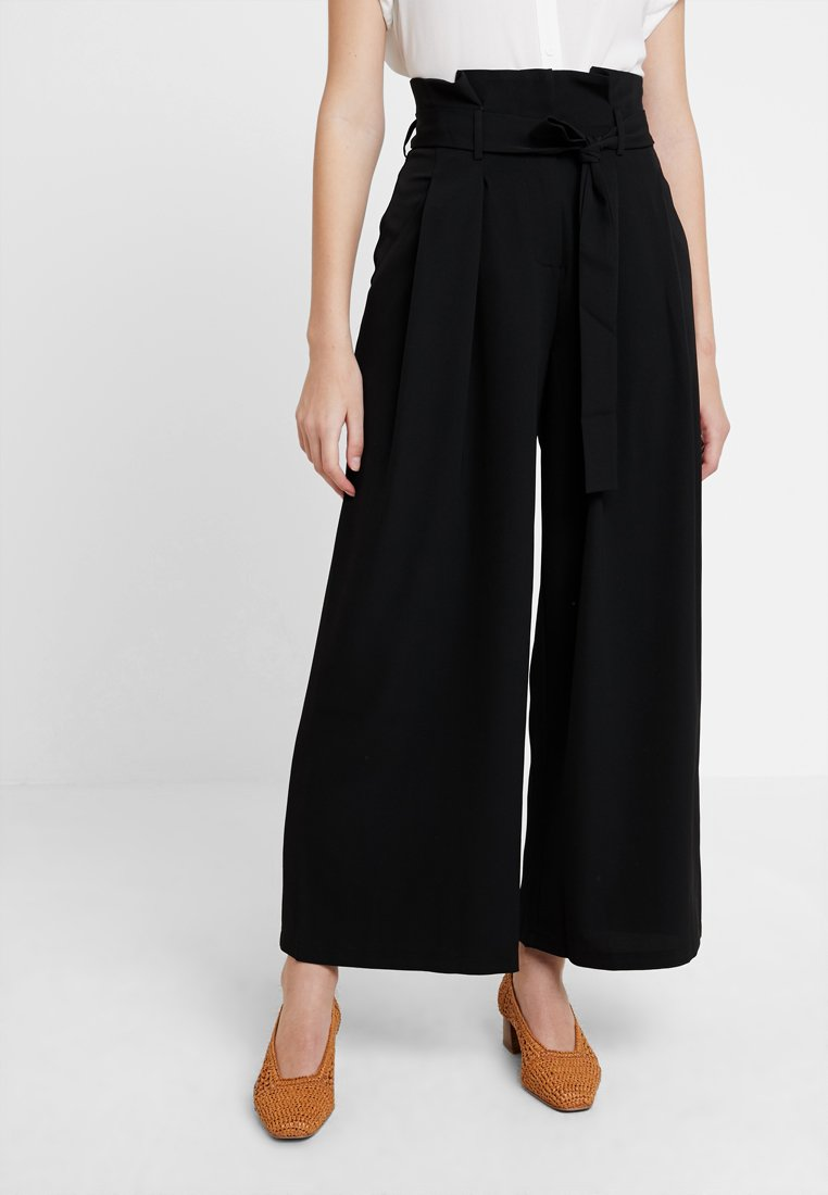 KIOMI - Trousers - black