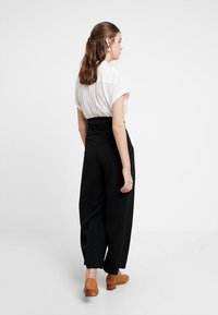 KIOMI - Trousers - black - 2