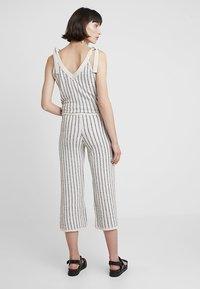 KIOMI - Trousers - beige/black - 2