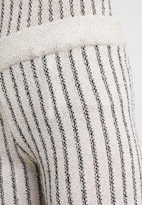 KIOMI - Trousers - beige/black - 4