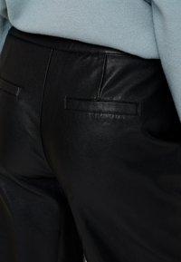 KIOMI - Trousers - black - 4
