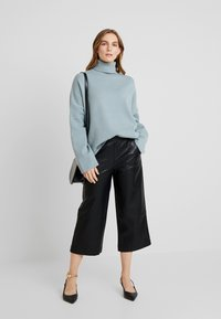 KIOMI - Trousers - black - 1