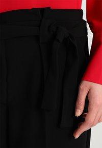 KIOMI - Trousers - black - 3