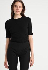 KIOMI - T-shirt - bas - black - 0