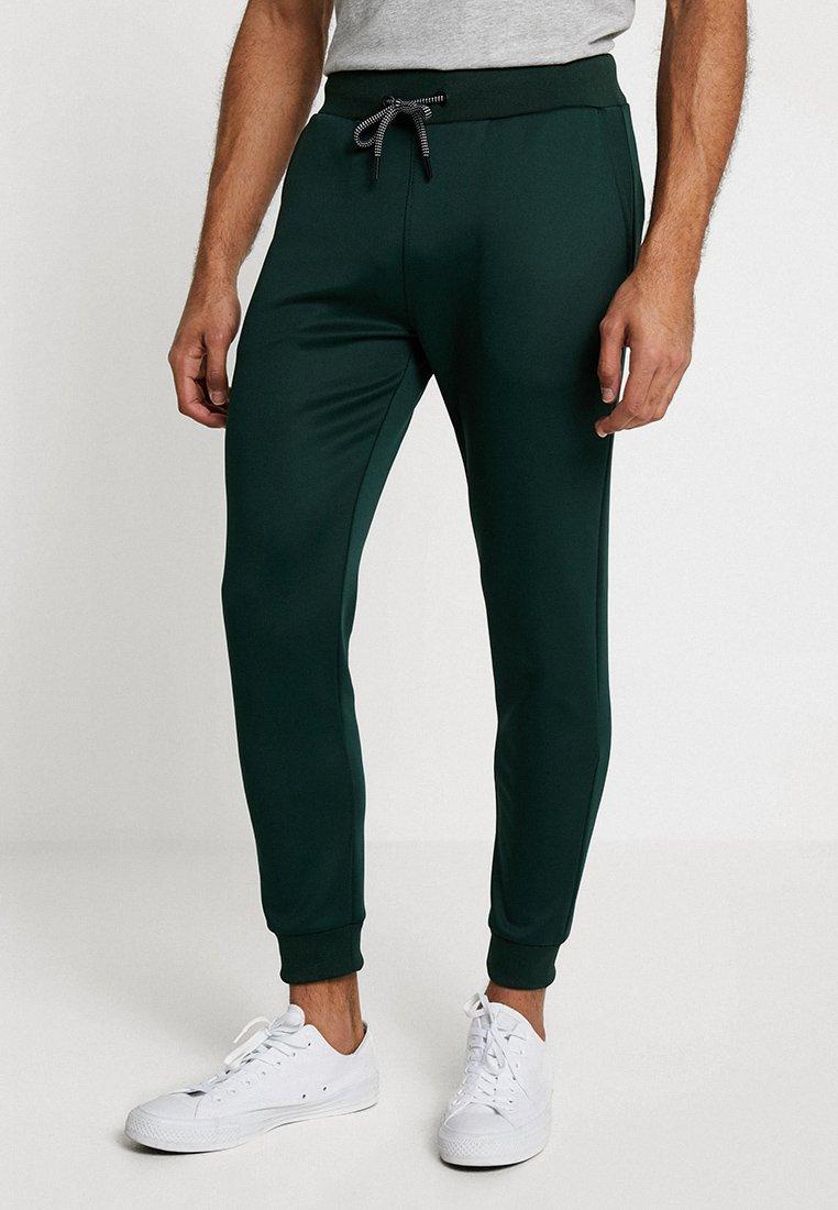 KIOMI - Spodnie treningowe - dark green