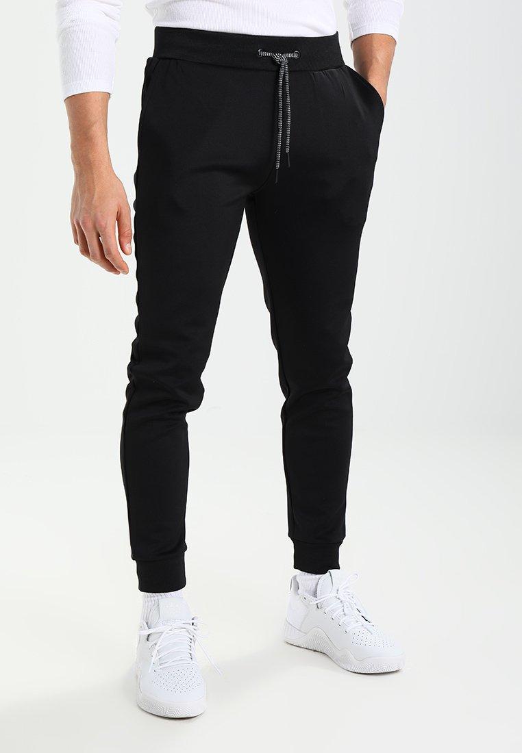 KIOMI - Spodnie treningowe - black