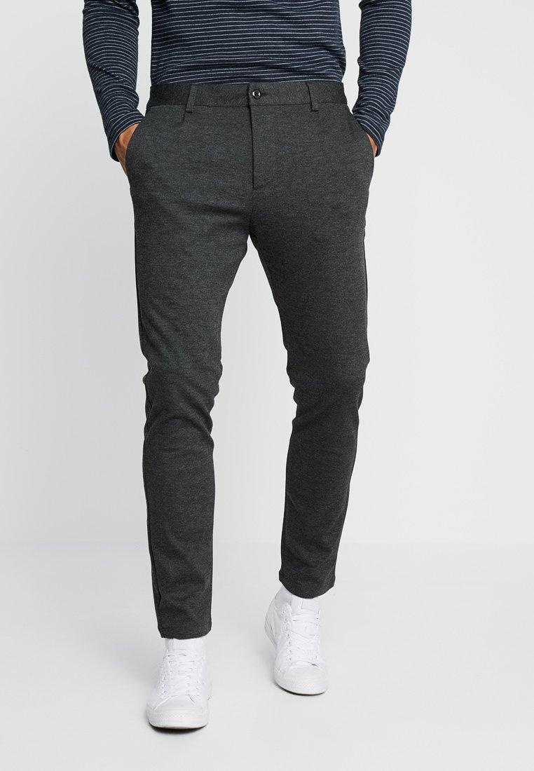 KIOMI - Trousers - mottled black