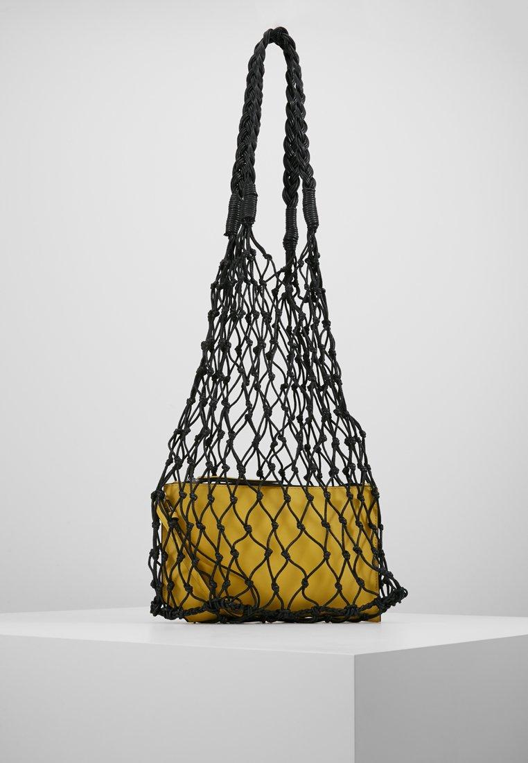 KIOMI - Handtasche - black