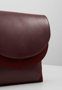 KIOMI - LEATHER - Across body bag - burgundy - 6