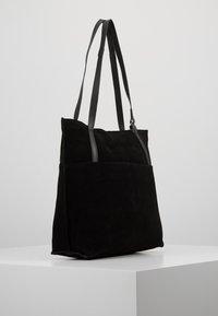 KIOMI - LEATHER - Tote bag - black - 3