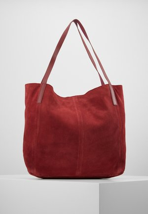 LEATHER - Tote bag - ruby red