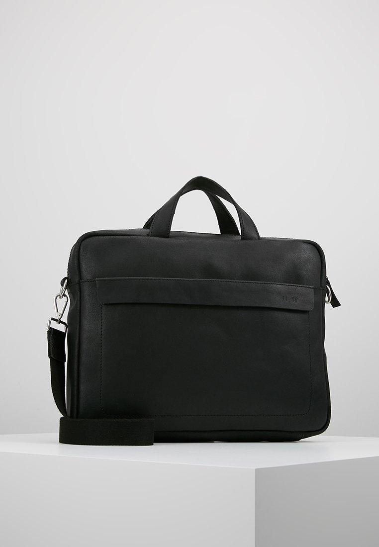 KIOMI - Stresskoffert - black