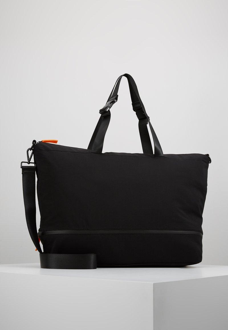 KIOMI - Weekend bag - black