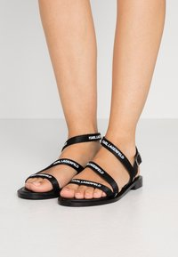 KARL LAGERFELD - SARABANDE FLAT STRAP  - Sandals - black - 0