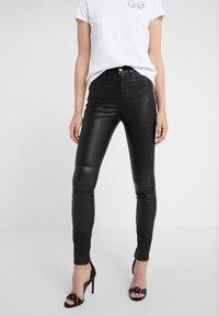 KARL LAGERFELD - PATENT BIKER PANTS - Pantalón de cuero - black - 0