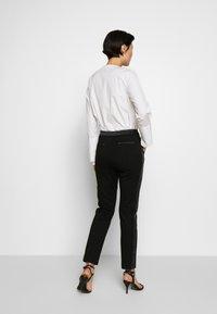 KARL LAGERFELD - PUNTO PANTS  - Trousers - black - 2