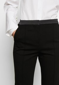 KARL LAGERFELD - PUNTO PANTS  - Trousers - black - 3