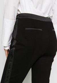KARL LAGERFELD - PUNTO PANTS  - Trousers - black - 5