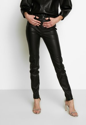 LEATHER BIKER PANTS - Leather trousers - black