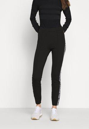 PUNTO LOGO - Leggings - Trousers - black