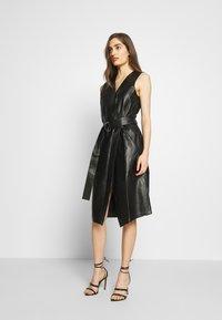 KARL LAGERFELD - LEATHER WRAP DRESS - Shirt dress - black - 0