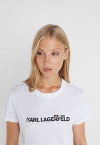 KARL LAGERFELD - IKONIK LOGO - Print T-shirt - white - 3