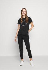 KARL LAGERFELD - CIRCLE LOGO - T-shirt print - black - 1