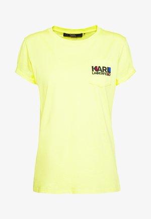 BAUHAUS LOGO POCKET TEE - T-shirt z nadrukiem - yellow