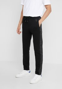 KARL LAGERFELD - PANTS - Pantalon de survêtement - black - 0