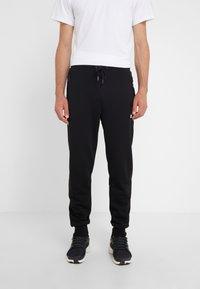 KARL LAGERFELD - PANTS - Pantalon de survêtement - black - 0