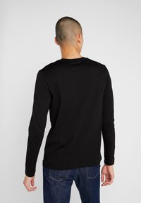 KARL LAGERFELD - LONGSLEEVE - Long sleeved top - black - 2