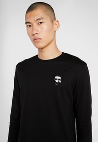 KARL LAGERFELD - LONGSLEEVE - Long sleeved top - black
