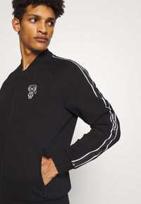 KARL LAGERFELD - ZIP JACKET - veste en sweat zippée - black - 4