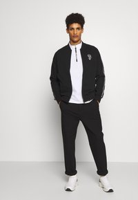 KARL LAGERFELD - ZIP JACKET - veste en sweat zippée - black - 1