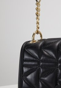 KARL LAGERFELD - KUILTED MINI HANDBAG - Handbag - black/gold - 7