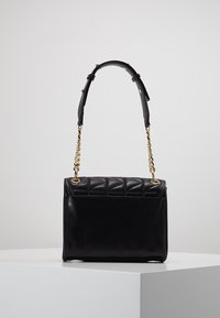 KARL LAGERFELD - KUILTED MINI HANDBAG - Handbag - black/gold - 2
