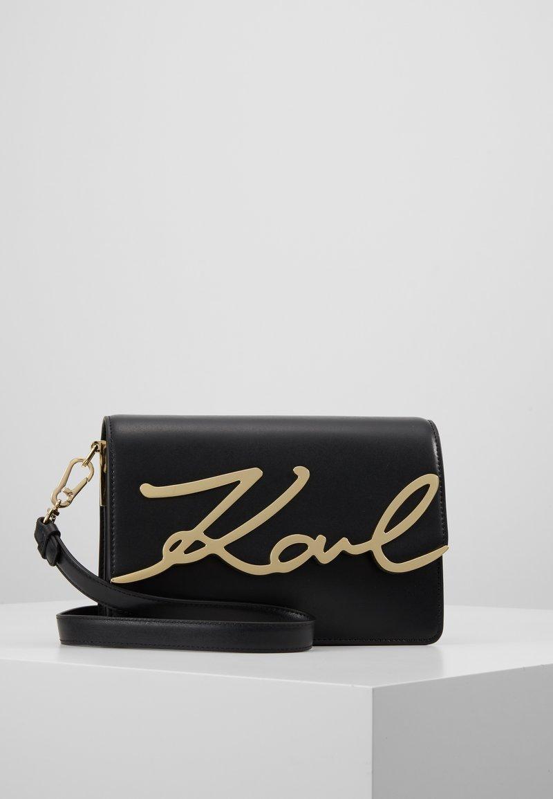 KARL LAGERFELD - SIGNATURE SHOULDERBAG - Across body bag - black/gold